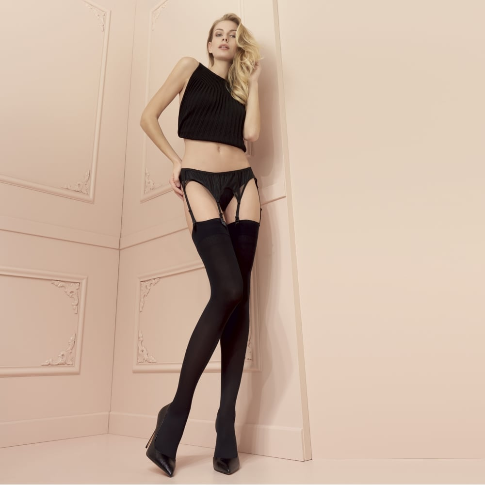 The Trasparenze Sandra opaque stockings have come in opulent deep tones which ideal for autumn and winter - black, brown, navy blue and anthracite gray. Reinforced in the toe for strength, the 70 denier microfibers are warm and soft, and a delicate diamond design .
