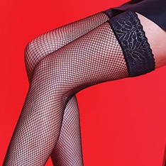Scarlet fishnet hold-ups with a lace top